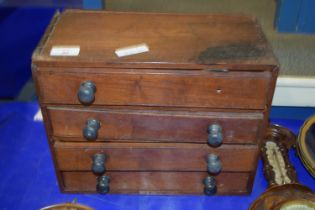SMALL WOODEN CHEST OF DRAWERS CONTAINING BEADS AND WRIST WATCH