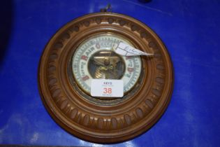 SMALL BAROMETER IN CIRCULAR WOODEN FRAME