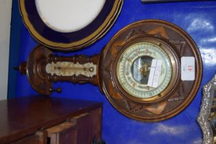 BAROMETER IN CIRCULAR WOODEN FRAME WITH THERMOMETER ABOVE
