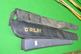 Three cue carrying cases