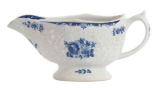 Lowestoft porcelain cream boat, the body impressed with a floral design enclosing a printed design