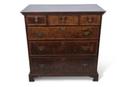 Early 18th century and later walnut chest, plain top over three drawers with three further full