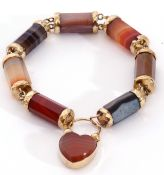 Scottish agate bracelet comprising seven various cylindrical banded agate faceted links, capped