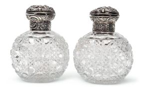 Pair of late Victorian hobnail cut oval glass scent bottles, the hinged lids and collars heavily