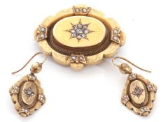 Victorian diamond and seed pearl set brooch and matching earrings, the centres each with old cut