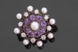 Amethyst pearl and diamond brooch centring a cultured pearl in cut down setting raised above eight