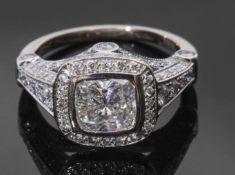 Precious metal single stone diamond ring, the cushion cut diamond weighing 1.20ct, bezel set