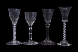 Group of four 18th century wine glasses, two with air twist stems, further glass with faceted