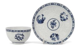 Lowestoft porcelain Hughes type tea bowl and saucer, the body with impressed floral design with