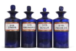 Group of four mid/late 19th century blue glass drug jars and stoppers, (4)