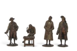 Group of four early 20th century Austrian miniature bronze figures including one of a teacher type