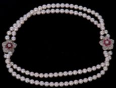 Double row cultured pearl necklace of uniform beads (7.38mm) with a double diamond and ruby