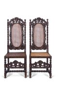 Pair of 19th century stained oak standard chairs in Carolean style, cresting rails featuring two