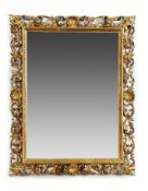 Late19 century carved gilt wood mirror, the frame of shell and scrolling foliate decoration, the