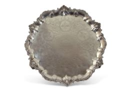 Large Victorian salver, circular shaped form on four cast scroll decorated bracket style feet, the