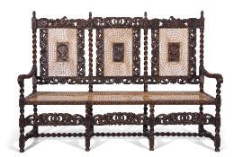 Late 19th century stained oak settee in Carolean style featuring eagle and coronet carvings, with