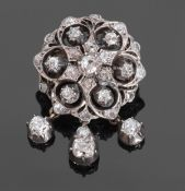 Victorian diamond cluster triple drop brooch/pendant, the circular pierced design with three