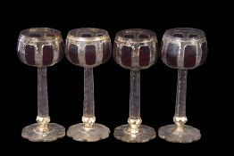 Group of four Bohemian goblets, the bowls flashed with a purple design above a faceted stem with
