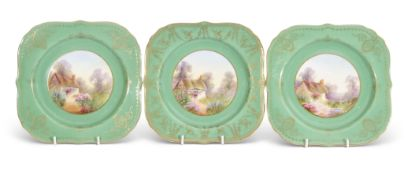 Group of three Royal Worcester shaped plates with gilt decoration on a green ground, the centres all