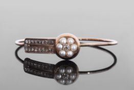 Antique pearl and diamond bangle, applied to the front with an old cut diamond and a pearl