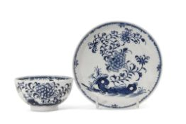 Lowestoft porcelain tea bowl and saucer decorated in underglaze blue with rock work and trailing