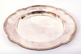 Elizabeth II silver presentation salver, circular form with gadrooned shaped border applied with