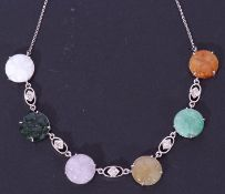 9ct white gold, jade and diamond necklace, a design featuring six carved jade discs joined by