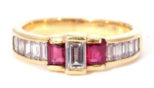 Diamond and ruby ring centring a baguette diamond between stepped cut rubies and slightly raised