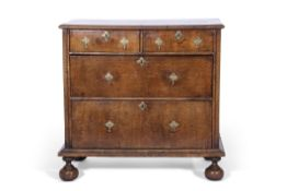 Early 18th century country walnut chest of two and two drawers with brass drop handles, the