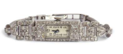 Art Deco Platinum cased diamond set cocktail watch, the swiss jewelled movement stamped M.P.G, on