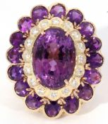 Large amethyst and diamond cocktail ring, the central oval faceted amethyst 20 x 12mm, four claw set