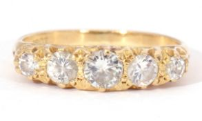 Diamond five stone ring featuring five graduated round brilliant cut diamonds, each individually