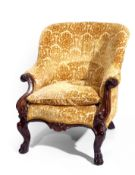 Victorian Mahogany framed Ladies chair, with carved front arms and paw feet covered in a yellow