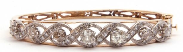 Diamond set hinged bracelet, featuring seven round graduated Victorian cut diamonds, 3.0ct approx,