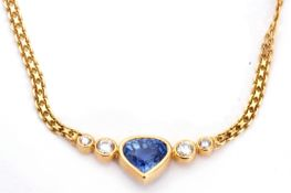 Italian tanzanite and diamond necklace centring a heart shaped tanzanite flanked by two graduated