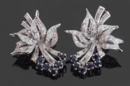 Pair of precious metal sapphire and diamond cocktail earrings, circa 1950, a floral bouquet