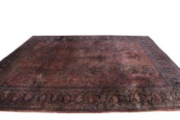 Early 20th century Persian Sarough wool carpet with floral and geometric design in blue and beige to