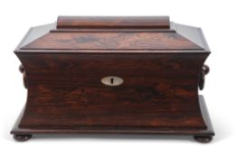 Late Regency period large rosewood tea caddy of concave sided sarcophagus form, the lid opening to