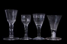 Group of four 18th century glasses, one with firing foot, one with faceted stem and engraved