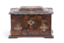Mid-19th century painted papier mache tea caddy of shaped rectangular form, the painted decoration