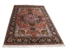 Fine quality wool and silk mix Caucasian style carpet, multi-gull border, large central lozenge with