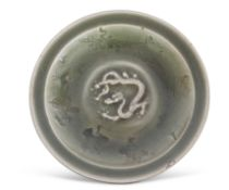 Longquan celadon dish, the centre decorated with sinuous dragon surrounded by a design of