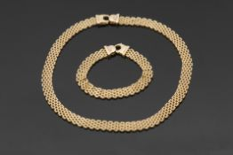 "High grade yellow metal Oms flexible brickweave necklace with lobster claw catch, stamped "".750"","