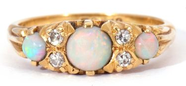 Mid-20th century 18ct gold opal and diamond ring featuring three graduated round cut cabochon opals,