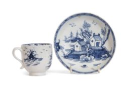Lowestoft porcelain cup and saucer decorated in underglaze blue with houses and trees, the saucer