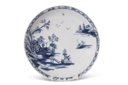 Lowestoft porcelain saucer dish decorated with a chinoiserie river scene, the border with small