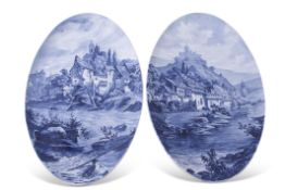 Two large late 19th century Continental plaques decorated with blue and white scenes, the decoration