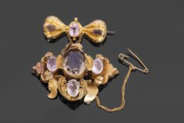 Victorian gold foil and ribbon design brooch with drop in rococo taste, set with semi-precious gem