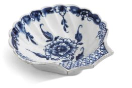 Lowestoft porcelain shell dish with scalloped rim, decorated in underglaze blue with a floral design