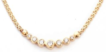 Diamond set necklace featuring seven graduated round brilliant cut diamonds, each individually bezel